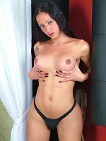 Shemale brunette shows her smooth round buns