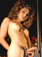Sassy t-girl rubbing her firm ass against the pole