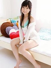 Beautiful pale skin asian goddess poses in her mint green bikini