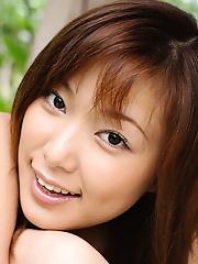 Yua Aida Asian teen model is sexy in her teeny bikini showing her pussy hair